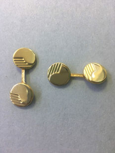 Men's gold cufflinks.