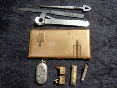 Two cuffs - 1 tie-pin - cigarette case - coin holder - cigar cutter - cut letter-opener - hair pin (Silver Gold & Silver) on iron