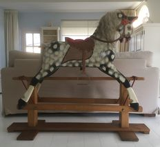 Rocking horse J. Collinson & Sons with book