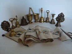 Lot of miscellaneous bronze/copper brass bells and two copper mortars.