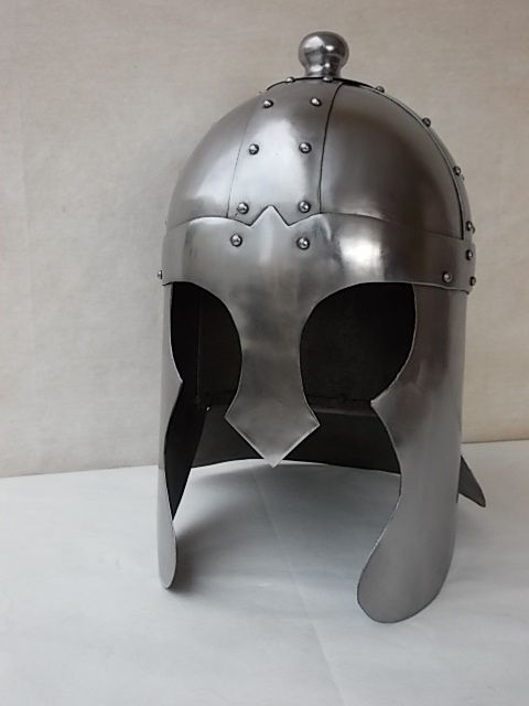 Important medieval helmet made by hand, the various parts are joined together with rivets, copy used in many movies, made of steel with head cover made in Italy