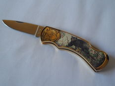 Franklin mint limited edition pocket knife with an image of a bear