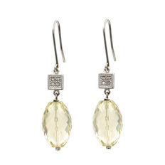 White gold earrings with brilliant cut diamonds and oval lemon citrine.