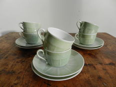 Six Victoria green mother of pearl porcelain tea cups and bowl