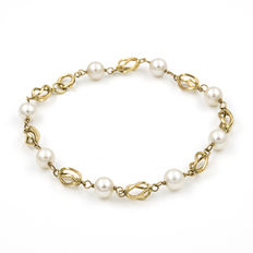 bracelet with birdcage designed and Akoya pearls 18 kt yellow gold – 8x natural salt water cultured pearls – Pearl diameter: 6 mm (approx.) – Length: 18.5 cm.