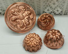 Four ancient copper cake pans