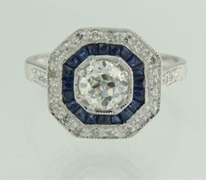 Platinum ring centrally set with a 0.80 ct Bolshevik cut diamond and an entourage of princess cut sapphires and single cut diamonds, ring size 17.25 (54)