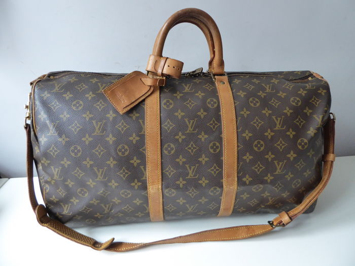 0c0a18d797d3 Louis Vuitton – Keepall 55 with shoulder strap - Catawiki