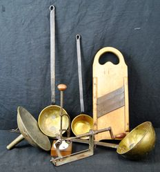 Lot of 7 kitchen tools. Including 3 wrought iron soup spoons with yellow copper. A very large decorative funnel and an olive stoner and 2 other items.