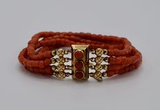 Bracelet with three strands of antique precious coral with a 14 kt gold clasp set with precious coral, 19th century