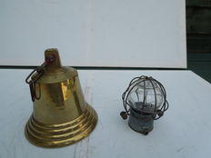 Copper bell and ship's lamp