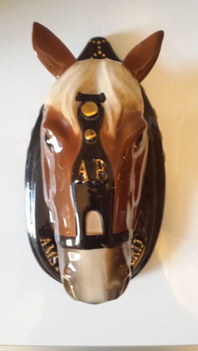 Large ceramic horse head with advertising for Amstel beer brewery