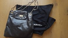 Chanel – Perforated leather expandable large flap tote bag