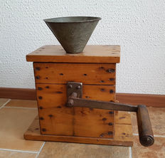 Large industrial cast-iron grain mill/coffee grinder with spinning wheel, ca. 1930, presumably from France