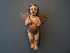 Large wood-carved brocante putti in soft tones