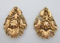 Two gold, traditional, dangle earrings.