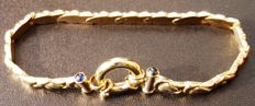 Yellow gold bracelet of 18 kt, 750/1000, with 4 sapphires