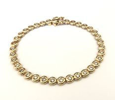 18 kt yellow gold tennis bracelet decorated with brilliant cut diamonds, H/VVS (1.08 ct in total)
