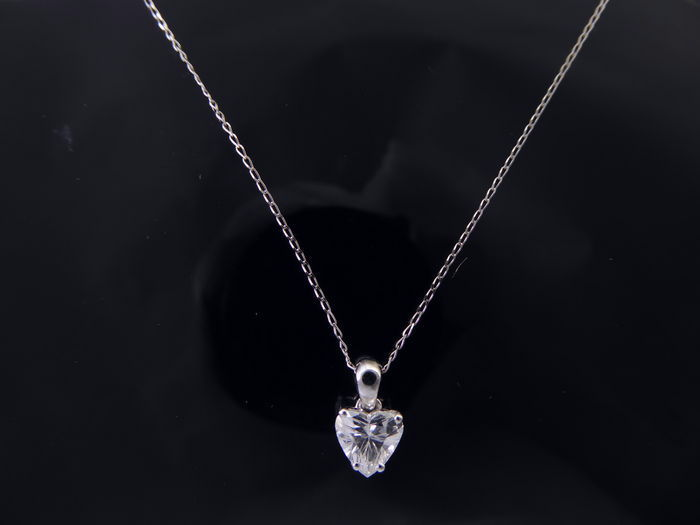 White gold heart shaped diamond pendant of 075 ct together with a white gold heart shaped diamond pendant of 075 ct together with a jewel certificate aloadofball Gallery