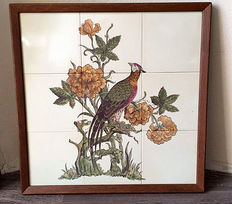A tile platter of a peacock, in wooden frame, mid 20th century