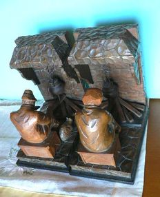 Pair of bookends in carved wood. Spain, 1920s-1930s