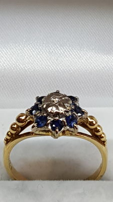 18 kt yellow gold women's ring set with blue sapphire and brilliant cut diamond