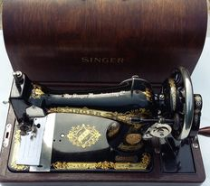 Beautifully decorated Singer 15K hand sewing machine with original wooden cover and key, 1930