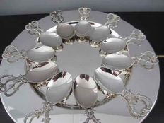11 decorated silver plated appetizer spoons on silver plated dish by Begeer