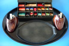 Four Bakelite items: LCGM calculation box, a set of shoe trees and 2 serving trays