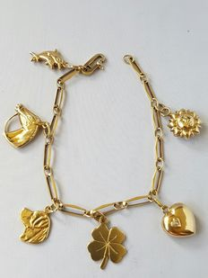 14 kt charm bracelet with 6 very special charms - total length: 18.5 cm.