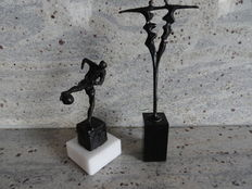 2 bronze sculptures on marble pedestals, Football player, Fruitful cooperation