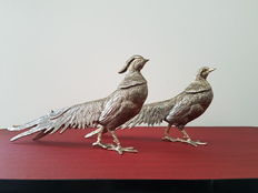 Two large silver-plated table pheasants.