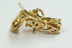 Gold pendant, motorcycle, 27 mm long.