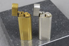 Two Cartier lighters, silver and gold plated - France