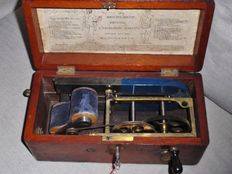 "Antique ""Magneto Electric Machine"" medical ""miracle"" device in wooden case."