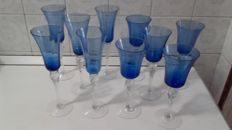 Crystal blue and white glass goblets for sparkling wine