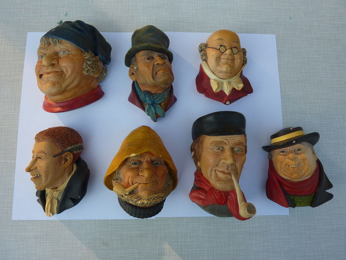 Seven vintage chalkware faces Bossons (5) and Legend (2)