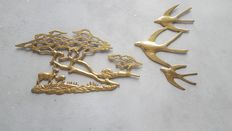 Lot of brass wall decoration with stylized tree and three stylized birds