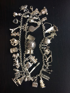 Silver 835/1000 – 18 cm – 100 g charm bracelet – 3 strings – 39 charms – No reserve price