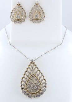 IGI Certified gold leaf shape Large pendant with large chandelier earrings with diamonds.