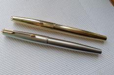 Two Parker pens Models 65 and 61.