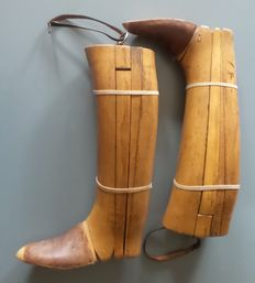 Beautiful French wooden boots tensioners with a metal ring on the top.