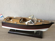 Hand made wooden model of a Riva speedboat.