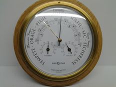 Barometer-thermometer-hygrometer for on-board cabin/office, brass on a hardwood base.