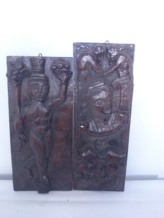 Pair of hand carved with high-relief wooden tables. Pre-Columbian style, second half of the 20th century. South America