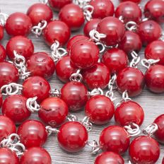 Rosary of coral stone beads with Sterling Silver.