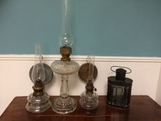 Three glass oil lamps and a lantern - circa 1920
