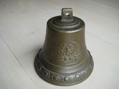 Beautiful copper bell with figures in relief