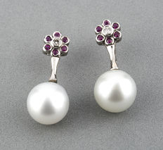 Earrings with central diamond of 0.10 ct, rubies of 0.50 ct and South Sea (Australian) pearls of 10.95 mm in diameter