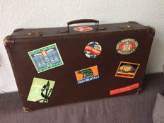 Old suitcase with hotel labels, decorative showpiece from the 1930s